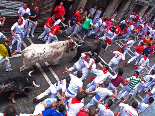 Pamplona, running of the bulls by Flickr user inthesitymad (used under creative commons)
